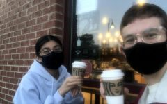Fabiana Miranda and Jeremiah Nohr sit and drink lattes.