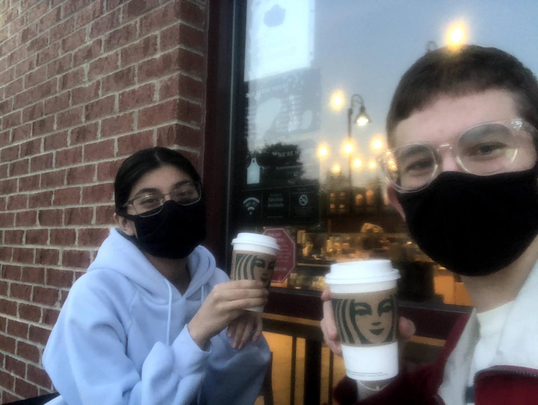 Fabiana Miranda and Jeremiah Nohr sit and drink lattes.