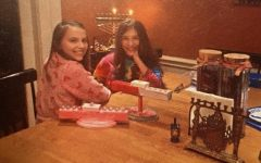Brooke(right) and Ivy(left) Seligman celebrate Hanukkah in 2015