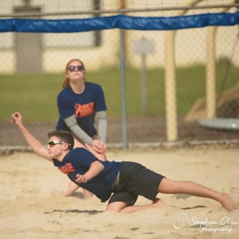 Sophomore Brady Plucker plays a game of sand volleyball