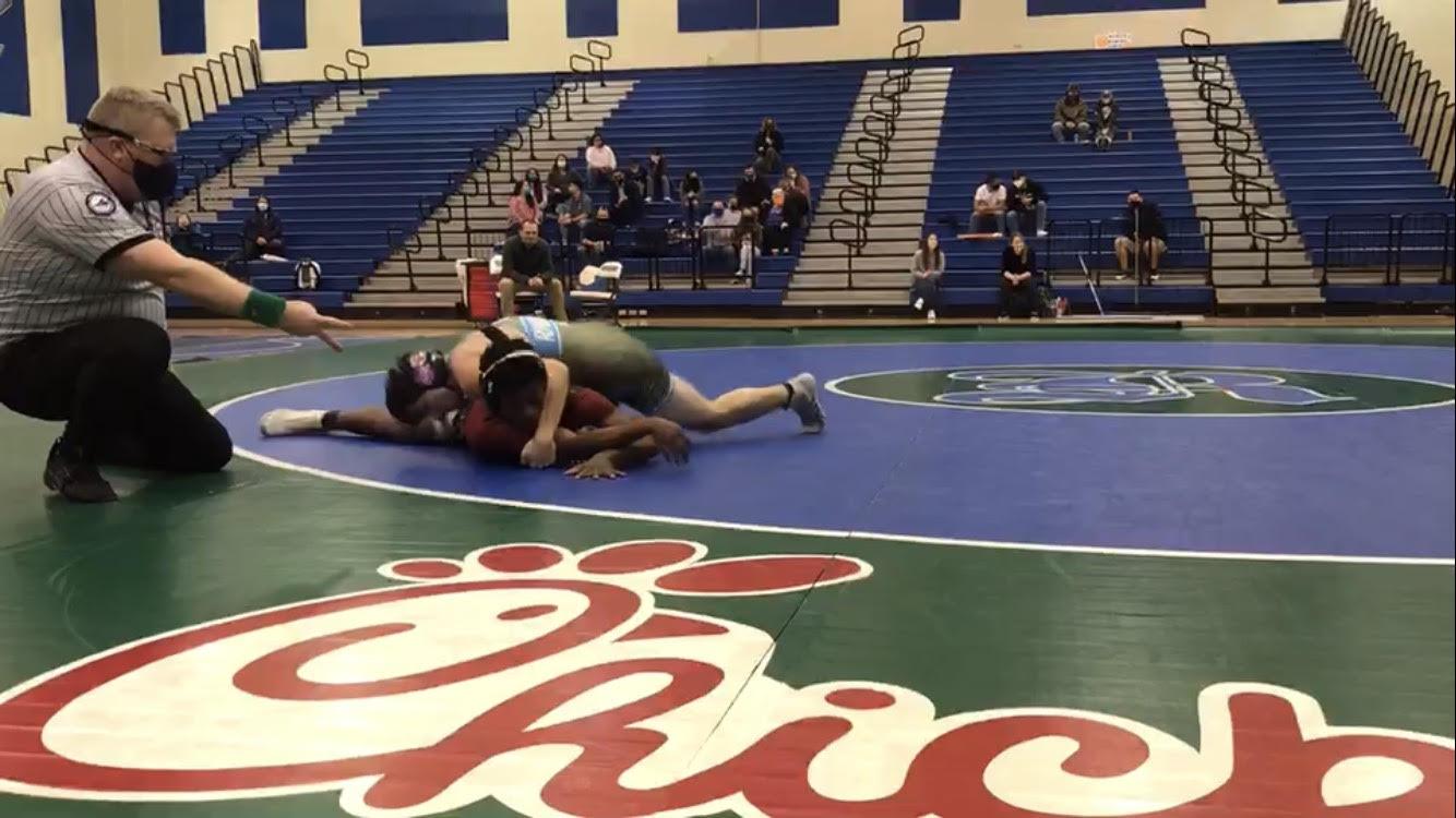 Nate Taylor wins his match at his senior night