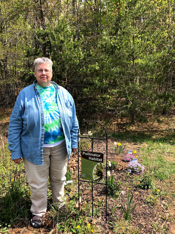 Ms. Way at the pollinator garden run by the school's environmental club