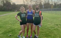 Seniors Jayden Haley, Kersten Smith, and Sarah Christy (left to right) pose together after running at the district cross country meet